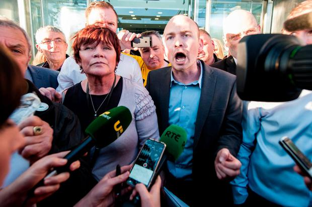 Socialist TD Paul Murphy and Joan Collins TD with water protest supporters speaking to the media outside court after they appeared in court in connection to water protests, 02-11-2015. Pic Collins Courts