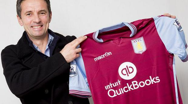 Remi Garde poses with a Villa shirt