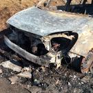 The Opel Zafira belonging to Maureen McCahill that burst into flames and was destroyed