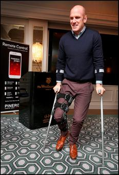 Paul O'Connell on his crutches at yesterday's press conference in Dublin