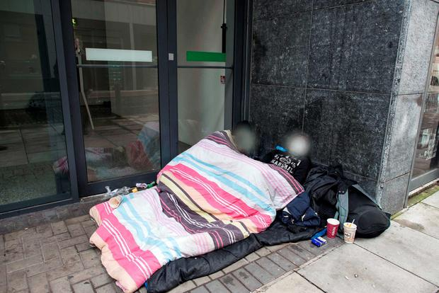 The couple, who are homeless, in a doorway on Foley Street