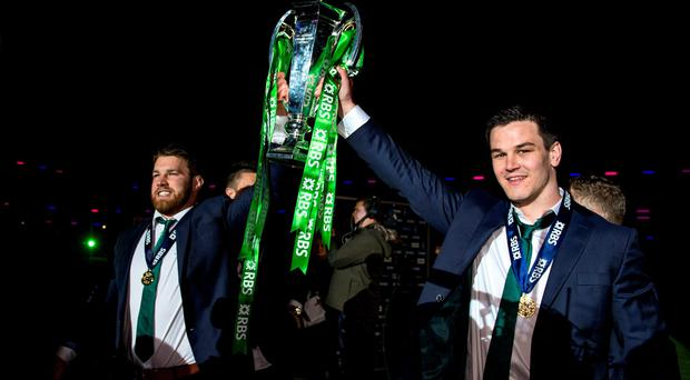 Ireland's Sean O'Brien and Jonathan Sexton with the Six Nations trophy at Murrayfield