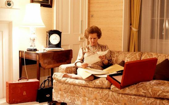 The former Conservative leader reading documents from her dispatch box at 10 Downing Street