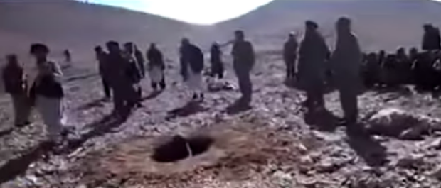 An image from the graphic video of Rokhsahana being stoned to death Credit:YouTube/ArianaAfghan