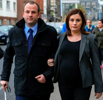 Eoin White, of The Walk, Carrigaline, Co. Cork, with his wife, Sarah, leaving court after he settled his High Court action against the HSE. PIC: COURTPIX