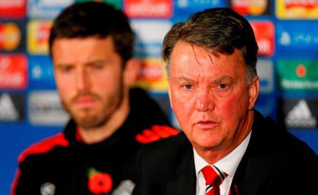 Manchester United manager Louis van Gaal and Michael Carrick during the press conference Action Images via Reuters / Jason Cairnduff