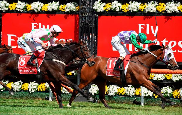 Michelle Payne drives Prince Of Penzance (right) to victory in the Melbourne Cup from Max Dynamite (Frankie Dettori)
