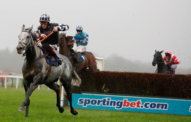 Sam Twiston-Davies and Vibrato Valtat (left) clear the last on the way to victory in the Haldon Gold Cup