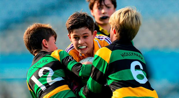 Theo Clancy of Scoil Lorcáin in action against Stephen McMahon (left) and Jaques de Patoul, Hollypark BNS during the Sciath Kitterick final of the Allianz Cumann na mBunscol festival of football in Croke Park