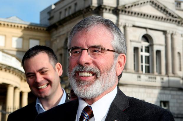 Sinn Féin president Gerry Adams and TD Pearse Doherty speaking to the media at Leinster House yesterday. Photo: Tom Burke