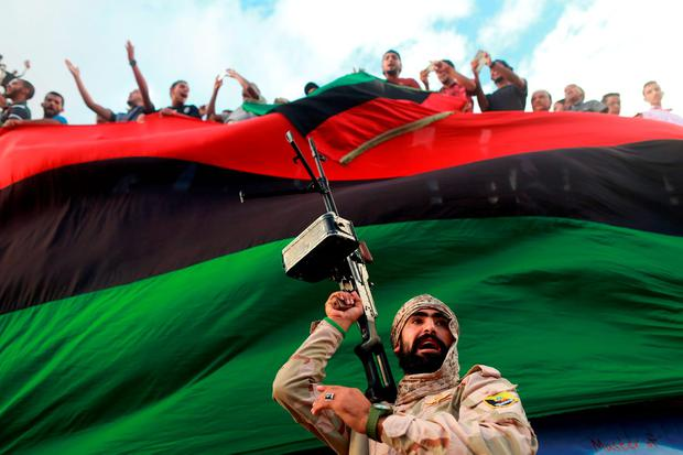 One of the members of the military protecting a demonstration against candidates for a national unity government proposed by UN envoy for Libya Bernardino Leon