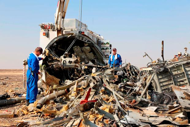Russian emergency services personnel working at the crash site of a A321 Russian airliner in Wadi al-Zolomat, a mountainous area of Egypt's Sinai Peninsula. Photo: AFP/Getty Images