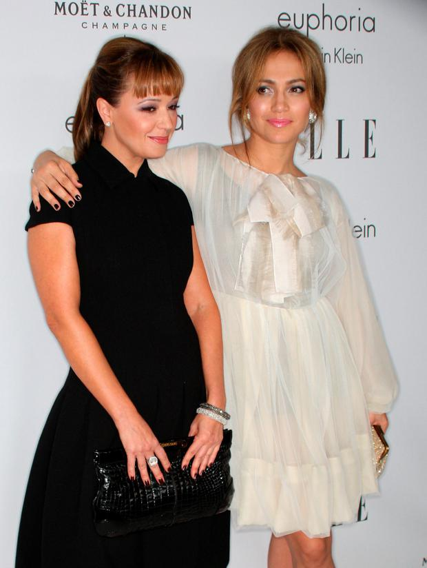 Actress Leah Remini and actress/singer Jennifer Lopez arrive at the 15th annual Women In Hollywood Tribute hosted by ELLE Magazine at the Four Seasons Hotel on October 6, 2008 in Beverly Hills, California. (Photo by Frederick M. Brown/Getty Images)