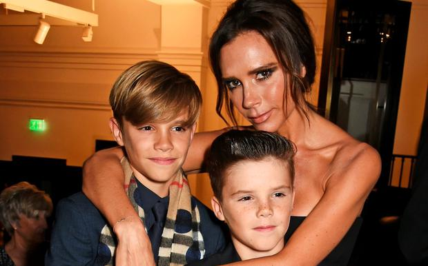 (L to R) Romeo Beckham, Cruz Beckham and Victoria Beckham attend the Burberry Festive film premiere at 121 Regent Street on November 3, 2015 in London, England. (Photo by David M. Benett/Dave Benett/Getty Images for Burberry)