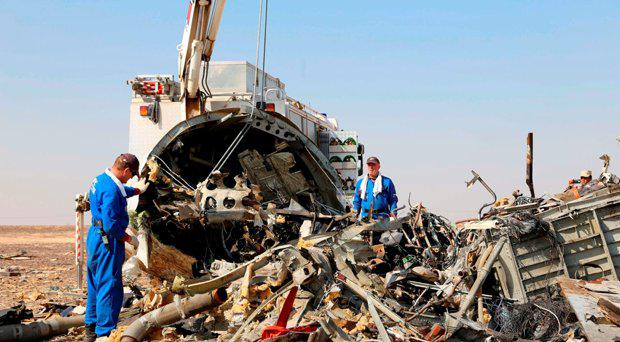 Emergency services personnel working at the crash site of a A321 Russian airliner in Wadi al-Zolomat, a mountainous area of Egypt's Sinai Peninsula