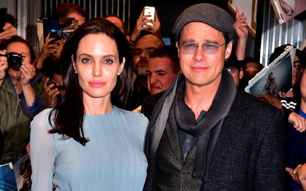 Angelina Jolie and Brad Pitt arrive to City Cinemas on November 3, 2015 in New York City. (Photo by James Devaney/GC Images)