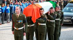 The coffin of Lieutenant Colonel Jack Griffin is carried from the church in Thurles