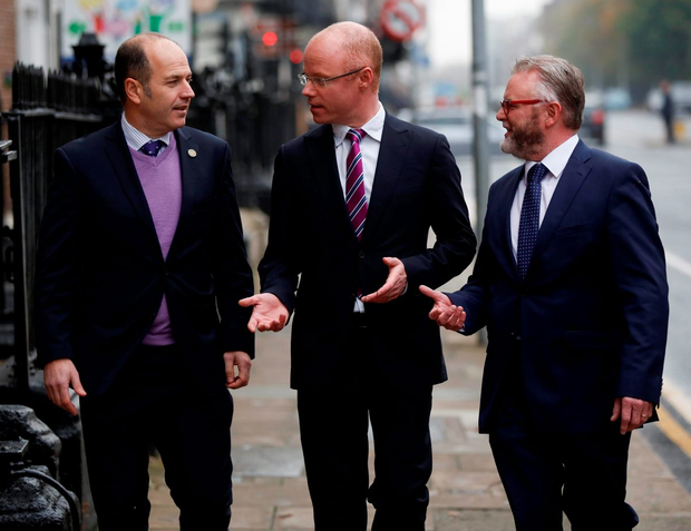 Dublin Chamber of Commerce president Greg Clarke (left) and Aebhric McGibney (right), its Public and International Affairs director, with Social Democrats leader Stephen Donnelly following a breakfast meeting where the TD set his group's plans for business and the economy