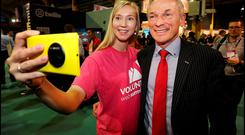 Jobs Minister Richard Bruton with volunteer Netta Huttunen from Finland at the Web Summit in the RDS