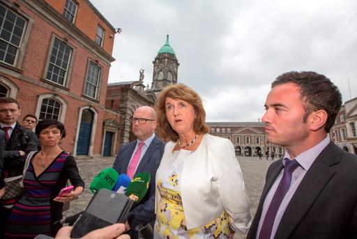 Tánaiste Joan Burton and Labour minister Ged Nash at the Forum for a Living Wage in Dublin Castle recently. The Government report on 'The prevalence of zero-hour contracts' should mainly have been looking for unscrupulous employers who break the rules and put workers on outlawed contracts
