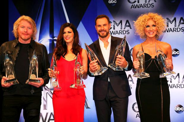 Little Big Town poses backstage with their awards for Vocal Group of the Year and Single of the Year during the 49th Annual Country Music Association Awards in Nashville, Tennessee November 4, 2015. REUTERS/Jamie Gilliam