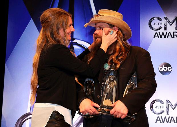 Musician Chris Stapleton and his wife, Morgane, pose backstage with his awards for Male Vocalist of the Year, New Artist of the Year and Album of the Year for Traveller during the 49th Annual Country Music Association Awards in Nashville, Tennessee November 4, 2015. REUTERS/Jamie Gilliam