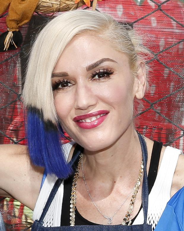 CULVER CITY, CA - OCTOBER 24: Singer Gwen Stefani volunteers at the Feeding America Holiday Harvest event at Shawn's Pumpkin Patch in partnership with the LA Regional Food Bank, supported by Bank of America Charitable Foundation on October 24, 2015 in Culver City, California. (Photo by Rich Polk/Getty Images for Feeding America)