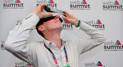 Ryan Tubridy tries out the Samsung Gear VR Oculus Glasses at the Web Summit at the RDS. Pic Steve Humphreys