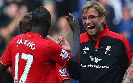 Liverpool manager Jurgen Klopp celebrates his team's 3-1 win over Chelsea with Mamadou Sakho