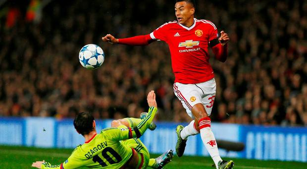 Manchester United's Jesse Lingard and CSKA Moscow's Alan Dzagoev in action Action Images via Reuters / Jason Cairnduff
