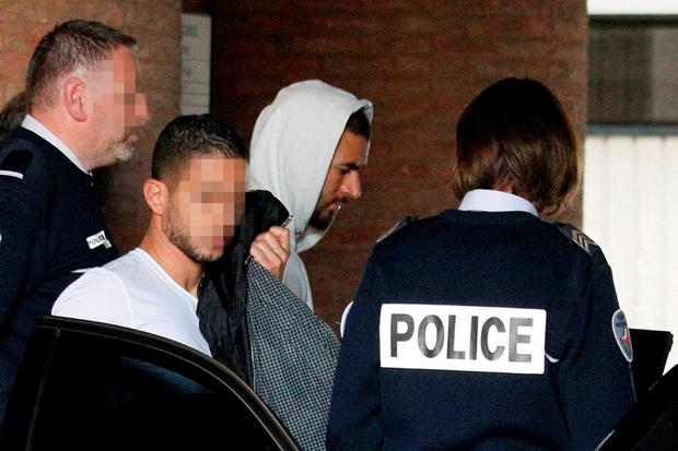 Real Madrid's French striker Karim Benzema leaves the court house in Versailles, near Paris