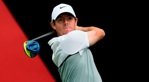 Rory McIlroy of Northern Ireland tees off during the WGC-HSBC Champions golf tournament in Shanghai today