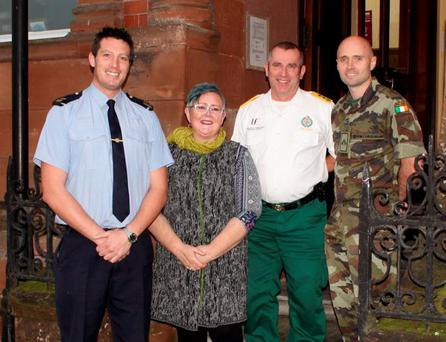 Garda David Barry, cancer survivor Joanie Hanley, paramedic Danny Howar, and soldier Ryan Conway launching the 'Brave Men Walking' fundraiser for the Irish Cancer Society