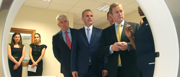 Minister for Communications Alex White, Affidea CEO Tom Finn, and Taoiseach, Enda Kenny listen to radiographer Zoe Muguni as they view a CT scanner at the official rebrand of Euromedic to Affidea Ireland and the announcement of the creation of 100 jobs over the next 18 months