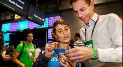 Ryan Tubridy chats with Veruska Anconitano from Rebrandly at the RDS. Photo: Steve Humphreys