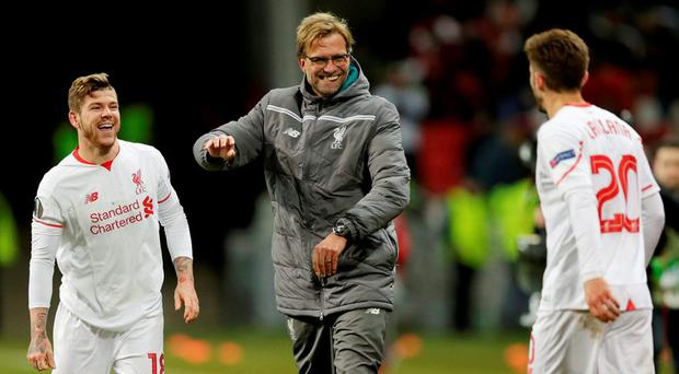 Liverpool manager Juergen Klopp celebrates with Alberto Moreno and Adam Lallana at the end of the match Action Images via Reuters / Henry Browne