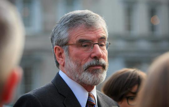 Sinn Fein President Gerry Adams TD during a Sinn Fein press briefing on Travellers' Rights on the plinth in Leinster House Dublin. Photo: Gareth Chaney Collins