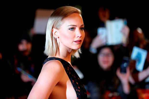 US actress Jennifer Lawrence arrives on the red carpet to attend the UK Premiere of the film