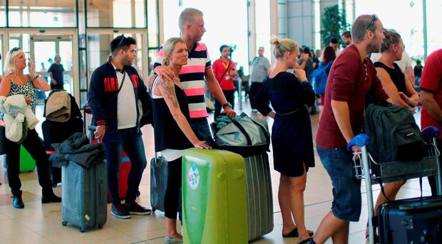 British tourists leave after finishing their holidays, at the airport of the Red Sea resort of Sharm el-Sheikh. Photo: REUTERS/Asmaa Waguih