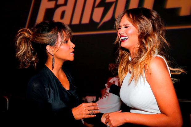 Actress Halle Berry (L) and model Chrissy Teigen attend the Fallout 4 video game launch event in downtown Los Angeles on November 5, 2015 in Los Angeles, California. (Photo by Rich Polk/Getty Images for Bethesda)