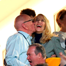 Rupert Murdoch and Jerry Hall embrace at the Rugby World Cup