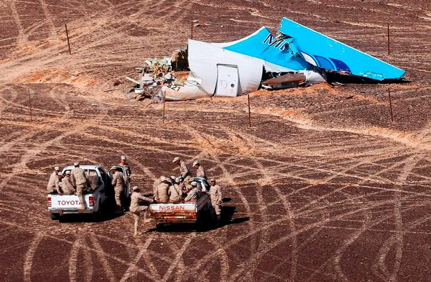 Egyptian military personnel find the tail of the Metrojet passenger plane that crashed in Egypt's Sinai desert