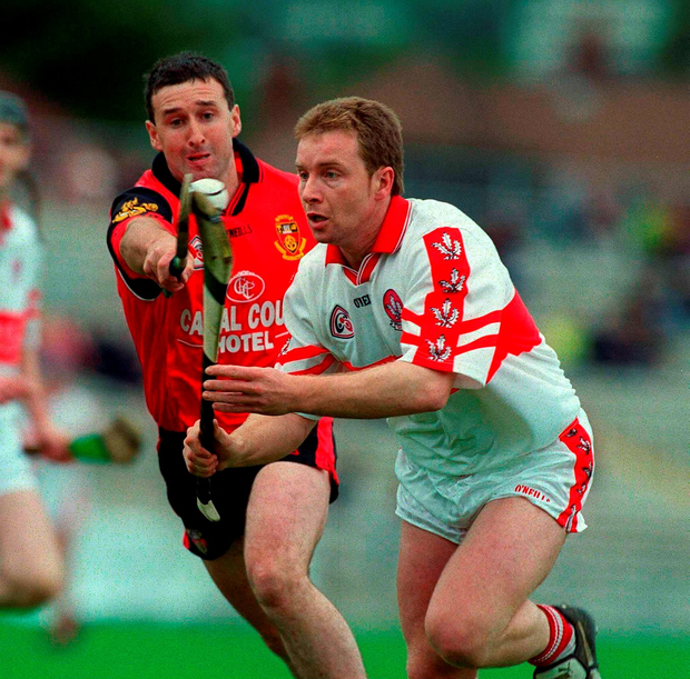 Derry's Kieran McKeever in action against Donal Byers, Down