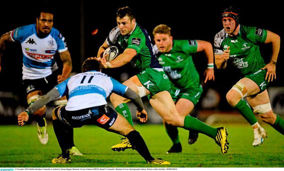 Robbie Henshaw, Connacht, is tackled by Simone Ragusi, Benetton Treviso. Guinness PRO12, Round 7, Connacht v Benetton Treviso. Sportsground, Galway. Picture credit: Seb Daly / SPORTSFILE