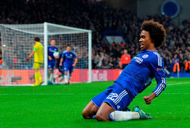 Chelsea's Brazilian midfielder Willian celebrates after scoring from a free kick during a UEFA Champions League group stage match between Chelsea and Dynamo Kiev at Stamford Bridge on November 4, 2015