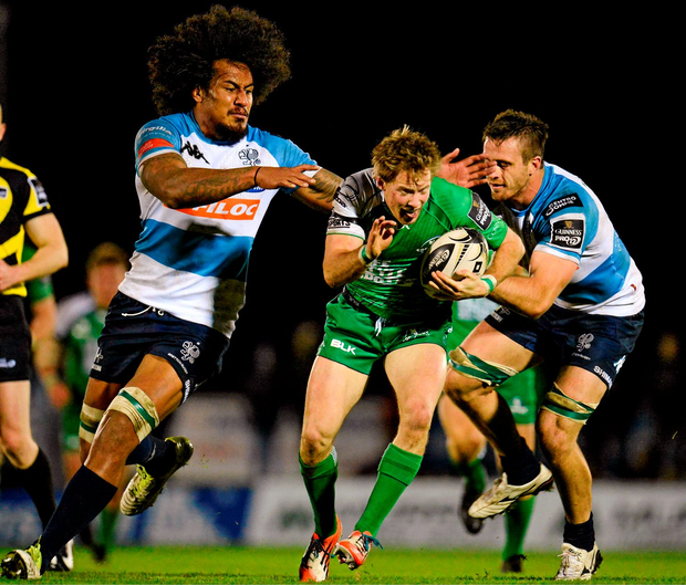 Kieran Marmion, Connacht, is tackled by Teofilo Paulo and Abraham Steyn, Benetton Treviso