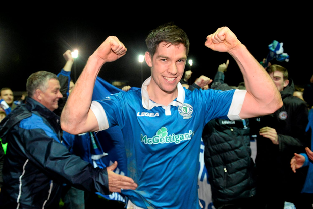 Packie Mailey of Finn Harps celebrates with fans after the game