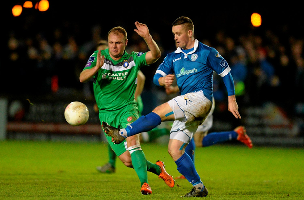 Kevin McHugh of Finn Harps in action against Robbie Williams