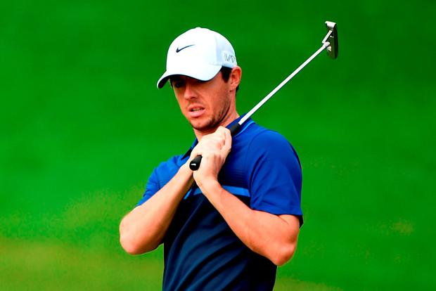 Rory McIlroy reacts after his putt on the 7th green during the second round of the WGC - HSBC Champions at the Sheshan International Golf Club on November 6, 2015 in Shanghai, China