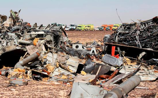 The remains of a Russian airliner are seen as rescue crews wait at the crash site in al-Hasanah area in El Arish city, north Egypt